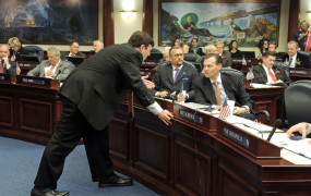 Conferring with Rep. Seth McKeel on the House Floor